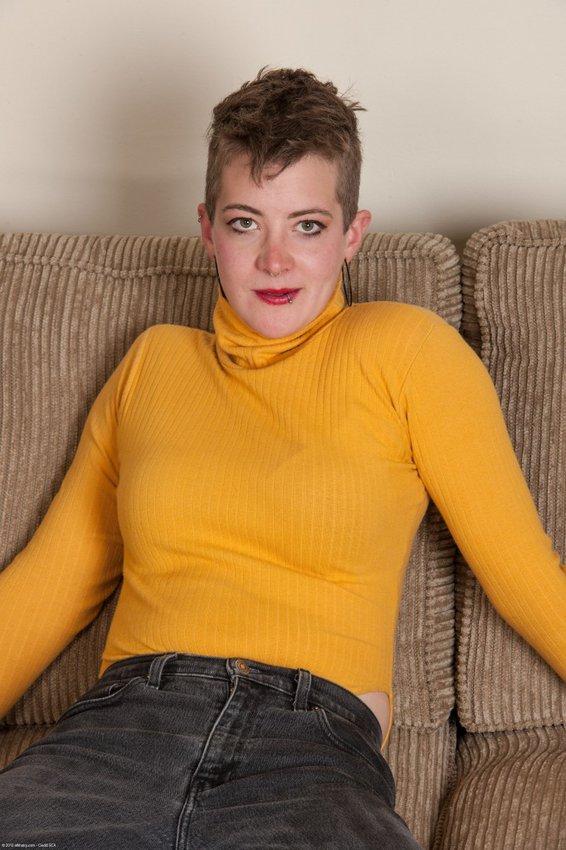 Teen girl bent over skirt