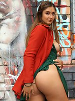 Hot teen shows hairy pussy on graffiti background