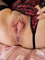 Hairy mature moans while fingering her vagina and ass